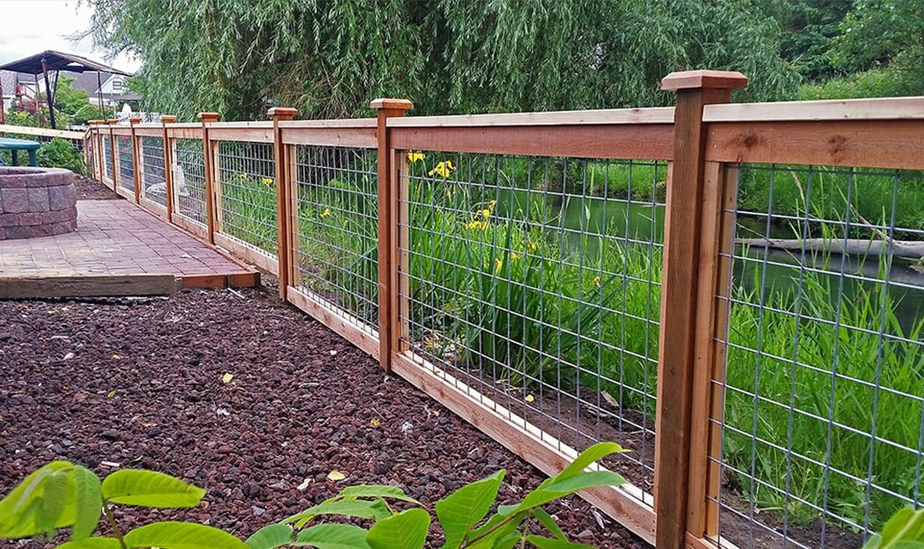 Astro Fence installs Wood Ranch Rail in Conroe Texas